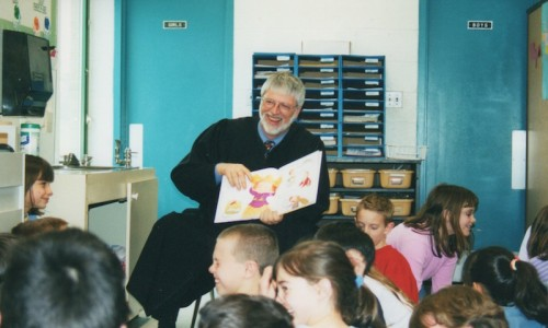JSI Founder Judge Brian MacKenzie (Ret.) reading to children