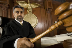 Sober as a judge refers to jurists being formal, somber or stuffy.
